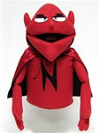 Red puppet with cape and evil eyes and pointy ears.  Puppet is wearing a red and black cape.