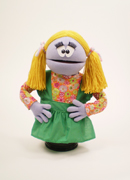 Lavender girl puppet with yellow pigtails.