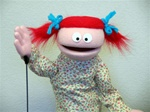 Small people puppet with red pigtails