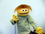 Yellow boy puppet with auburn hair.