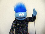 small blue boy puppet with blue hair