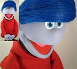 "16"" professional cartoon puppet with grey skin, freckles and dark blue hair."