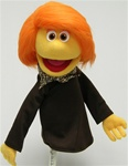 "16"" girl puppet with yellow skin and orange hair."
