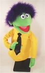 "Mardy is a professional hand puppet that measures 16"" tall and has green skin and purple boa hair."