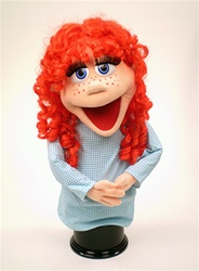 Rubee is a female puppet with a real human style red wig, peach skin and red freckles.