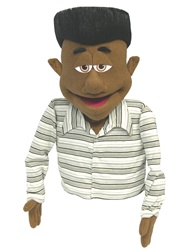 Max is a cocoa skin professional puppet with a black flat top. African American puppet.