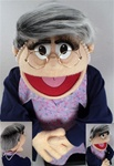 Ms. Moody is a women puppet with salt and puppet hair and glasses.