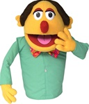 Mr. Quimper is a yellow cartoon puppet with red nose, bow tie and long sleeve shirt.